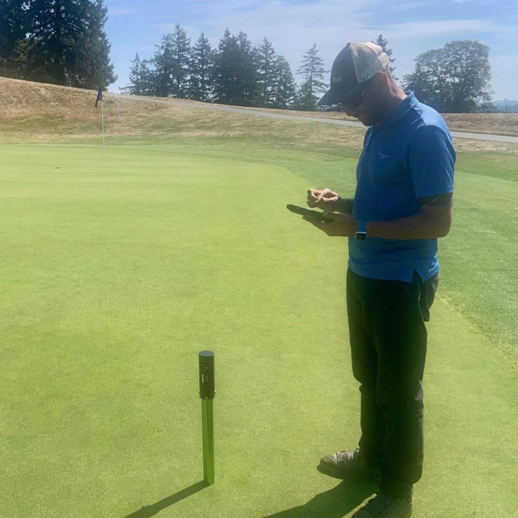 Maintenance Team Taking Measurements of Green Moisture